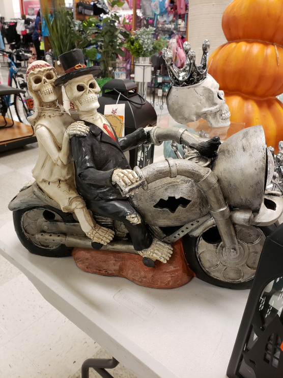 Skeleton couple on a motorcycle